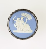 Round blue jasper medallion with white relief of Venus chiding  Cupid, set in silver as a brooch