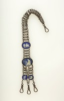 Chatelaine of cut steel beads with four blue jasper cameos, the two larger oval ones with white relief scenes of sacrifice to Cupid and Conquered Province, the two smaller round ones with unidentified scenes