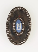 Oval blue jasper cameo with white relief of two figures, set in steel as buckle