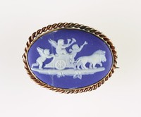 Oval dark blue jasper cameo with white relief of putti in cart pulled by lions, set in white metal as a brooch