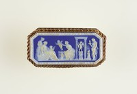 Octagonal dark blue jasper cameo with white relief scene with Cupid, set in gold as a brooch