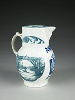 """Jug of white, soft-paste porcelain with cabbage leaf molded relief decoration on the main body, with long cylindrical neck molded in relief in a kind of fluted pattern with a border at the lip of repeating leaf and dot motifs (somewhat obscured by the lead glaze), with loop and scroll handle and small beak spout with molded mask; the jug with printed patterns on three sides, on either side of the main body the """"Iron Bridge"""" pattern and below the spout the """"Broseley Pipe Smoker"""" pattern above which a small sprig of grape vine with leaves and a bunch of grapes, on the neck above each side with the """"Iron Bridge"""" pattern a demilune with blue sky and fluffy white clouds; the interior lip also printed in blue with a narrow band of circles and dots, two white stripes, and a wider band of Asian-like geometric forms and flowers, a variation of the so-called Fitzhugh pattern."""