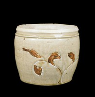 Tall jar with inlaid vegetal decoration.White-Glazed Wide-Mouthed Jar Carved with Leaf Motif Glazed with Iron-Brown