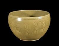 Bowl with carved vegetal design on exterior.