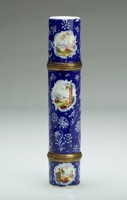 Enameled copper cylindrical traveling writing case with royal blue ground and white reserves painted with small, delicate landscape scenes, with a detachable cover at each end to reveal an inkwell at one end and a container for a pen at the other, with gilt metal mounts.