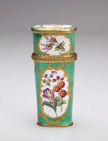 Enameled copper etui with a bright green ground and white reserves framed by gold scrolled elements, inside each is painted with colorful garden flowers, with gilt metal mounts.