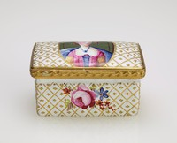 Small rectangular, enameled copper box the lid and sides painted in a gilt lattice work pattern with floral sprays on the sides, the lid with an oval reserve in which is painted the half-length portrait of a woman, with gilt metal mounts.