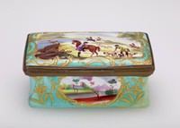 Rectangular enameled box with a turquoise green ground with gold highlights, the lid painted with the scene of a stag hunt and the sides with small reserves painted with landscape scenes, the inside of the box on the bottom printed with the scene of a bear hunt in black.