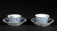 Small teacup and saucer with floral designs inside and out.
