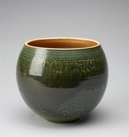 Vase with a round, exaggerated cup shape. The vase's exterior is colored dark green that tapers to light green towards the base of the bowl. There is a buildup of dark glaze around the center of the vase that appears to be dripping down the form in places. The vase's exterior is rough in texture around the top and bottom of the vase, with thin, irregularly-sized horizontal lines around the form. the rim of the vase is unglazed, beige stoneware. The vase's interior is partially glazed, the upper half of the itnerior ranging in color from orange to dark red. The lower half of the interior is light green, then the interior's center is dark red. The interior also features the same thin, horizontal lines that are on the exterior.