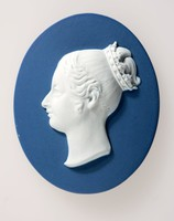 Oval blue jasper medallion with white relief profile portrait of Queen Victoria (1819-1901) facing left. Queen of Great Britain and Ireland, Empress of India; only child of the Duke Of Kent and Victoria Maria Louisa of Saxe Coburg; born at Kensington Palace, 1819. She was crowned in 1838, and in 1840 married Prince Albert of Saxe-Coburg-Gotha by whom she had nine children. Victoria had strong likes and dislikes among the politicians of the day, and although she was, on the whole, a constitutional sovereign, she retained a keen appreciation of her own powers.