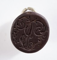 Oval self-shanked black basalt intaglio or cypher with white metal ring