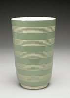 Simple vase, Keith Murrary shape 4216, of cream-colored body, covered with a celadon green slip. Four series of closely-spaced, parallel, engine-turned lines encircle the body to reveal the lighter body beneath the slip. The interior of the vase and flared pedestal are cream-colored.
