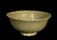 Bowl with notched rim and molded design of cranes, fungus of immortality, clouds and lotus blossoms in eight panels, light brown wash to base.