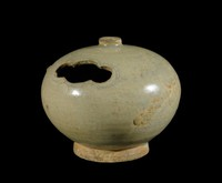 Incense burner of simple round shape with cut-out section for smoke to escape, knob top.