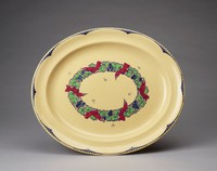 """Large oval platter of caneware in the concave shape decorated in the """"Nerots"""" pattern, the border with a scalloped edge in blue underglaze enamel with a modified fish scale pattern likewise in blue at the indentations, the center with an oval wreath of stylized green flowers and blue berries with six bright red birds resting on it, with six small line-drawn butterflies scattered about."""