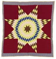 Lone Star quilt, on maroon background