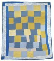 Blue and gold blocks quilt.