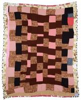 Pink strip quilt.