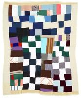 PInk, black, and white blocks quilt.