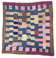 Blue, pink, and plaid strip quilt.
