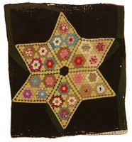 Mosaic Lone Star quilt, with black background