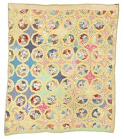 Spiderweb star quilt in pink and yellows.