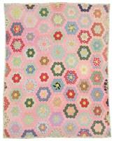 Pink grandmother's flower garden quilt.