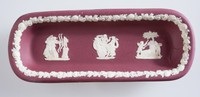 Crimson and white dish or tray probably for a pen or quill featuring various classical reliefs including the Archers, the Three Graces and Psyche wounded and bound by Cupids,