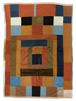 """Early blocks quilt in brown corduroy, """"made before I knew how""""."""