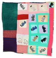 Quilt with fourteen dogs and two frogs.