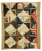Log Cabin/Sunshine and Shadows quilt, with brown and white polka dot borders