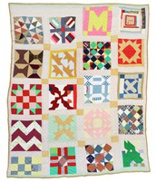 Everybody quilt with green mule in corner.