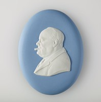"""Oval blue jasper medallion with white relief profile portrait of Winston Churchill smoking a cigar (1874-1965) facing left. Winston Churchill was a British politician who was Prime Minister between 1940 and 1945 and again between 1951 to 1955. As Prime Minister, Churchill led Britain to Victory against Nazi Germany. He is well known for his famous speech """"Never in the field of human conflict was so much owed by so many to so few"""""""