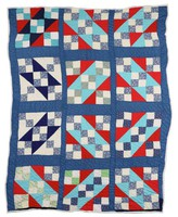 Rocky road to Georgia quilt in red, white, and blues.
