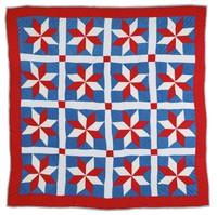 Patriotic stars quilt in red, white, and blue.