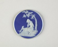 Delicate, thin medallion of white jasper with dark blue jasper dip and white relief decoration with the scene of Poor Maria.