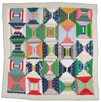 Log cabin quilt in bright colors