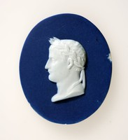 Oval dark blue jasper medallion with white relief profile portrait of Napoleon (1769-1821) facing left wearing a laurel wreath. Napoleon was the French Emperor reigning between (1804-1814) before taking control of Italy between 1805 and 1814.He was banished to Saint Helena where he died of cancer of the stomach with his body being returned tio Paris in 1840, 19 years after his death to be placed in the crypt of the Invalides.
