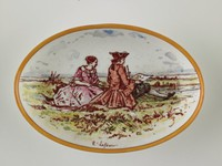 Small oval dish, painted with seated man and woman