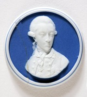 Round dark blue jasper portrait medallion with white relief portrait of William Pitt (1759-1806), younger son of Earl of Chatham, English statesman and successful orator, he entered Parliament in 1781 and became Chancellor of the Exchequer in 1782, aged 23, and First Lord of the Treasury and Chancellor of the Exchequer before he reached his 25th Birthday. In 1800 he was responsible for the Union of Great Britain and Ireland.