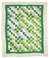 Four patch with sixteen patch quilt in green and yellow.