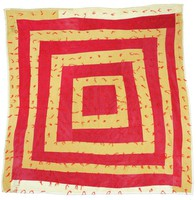 Housetop quilt of tacked corduroy.