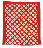 Lattice quilt in red and white.