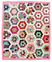 Grandmother's flower garden quilt.