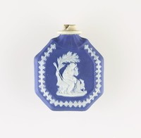 Ocatagonal dark blue jasper perfume bottle with white relief of Poor Maria on one side, and The Bourbonnais Shepherd on the other