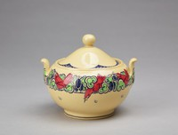"""Small covered sugar bowl of caneware decorated in the """"Nerots"""" pattern, the bulbous bowl with a central band of stylized green flowers and blue berries with six bright red birds resting on it and six small line-drawn butterflies scattered about, with two short, stout, slightly curved handles, the domed cover with a scalloped edge in blue underglaze enamel with a modified fish scale pattern likewise in blue at the indentations, with ball finial."""