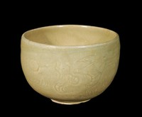Bowl with carved design of dragon chasing a flaming jewel of wisdom.