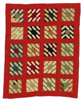Lozenge quilt, red borders and background, dark brown lining, quilted with brown thread in shell patterns