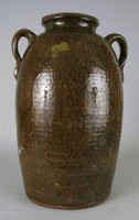 Jug with one strap-handle on either side of shoulder